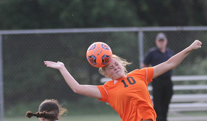 Allyson Yesh of Sturgis heads a ball on target against Buchanan on Monday evening.