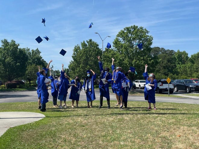 Southeast Area Technical High School seniors celebrate their graduation May 22. The 10 graduates were part of the first commencement ceremony in the school's history.