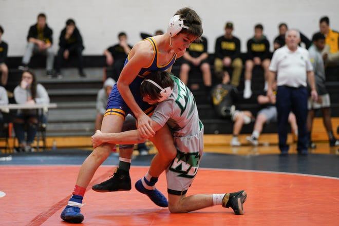 Laney's Mark Samuel (left) and West Brunswick's Christian Zickefoose during the 106-pound final of the 2020 Mideastern Conference wrestling tournament. In 2021, both standouts have had fewer opponents because of forfeits.