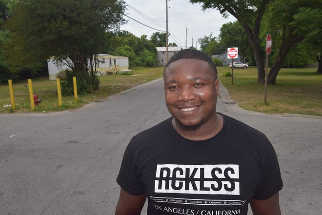 First Avenue resident Steven Holloway is pleased that new addordable rental units are coming to his Five Points neighborhood, behind him to the left.