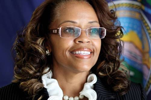 Kenya Cox will step down as executive director of the Kansas African American Affairs Commission, Gov. Laura Kelly's office announced Tuesday.