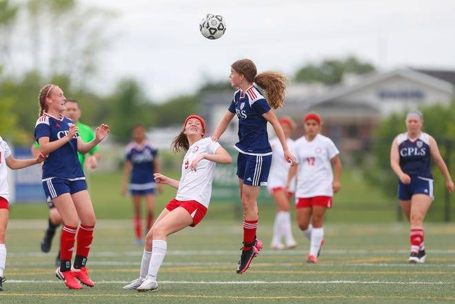 Cair Paravel's Katherine Keys heads the ball away from Miege in the first half of Tuesday's game at Bettis Family Sports Complex. Miege won 4-0 to advance to the Class 4-1A state semifinals.