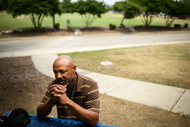 Larry Jonson talks to a reporter about what the Fayetteville homeless community needs.
