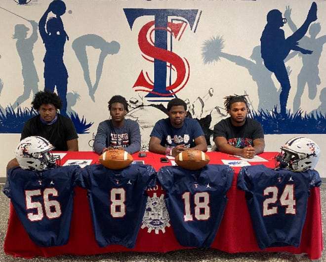 Terry Sanford football's Brandon Roye, Sequan Smith, Jarvis Higgins-Simmons and Jaquan Shepard took part in a signing ceremony Monday.