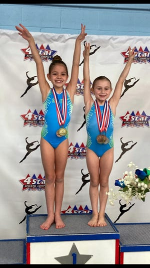 Kate O'Neill, left, and Jordan Blair won all-around titles at the Maryland Level 2 State Championships.