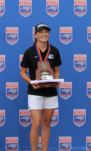 Eastern Alamance sophomore Emily Mathews poses with the NCHSAA Class 3-A individual state championship trophy for girls' golf.