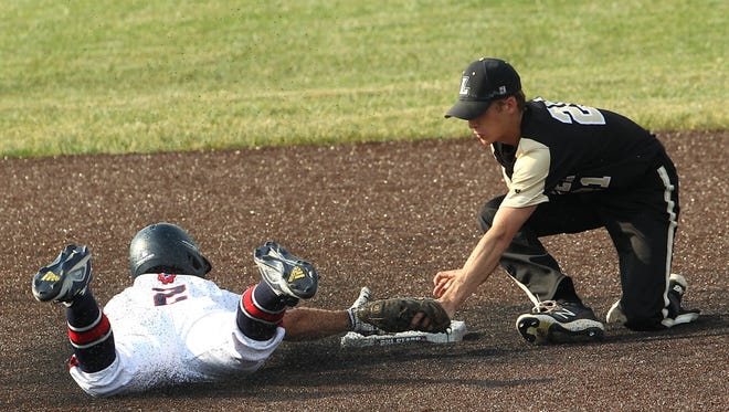 Loogootee's Luke Nonte attempts to make the tag against BNL earlier this season.