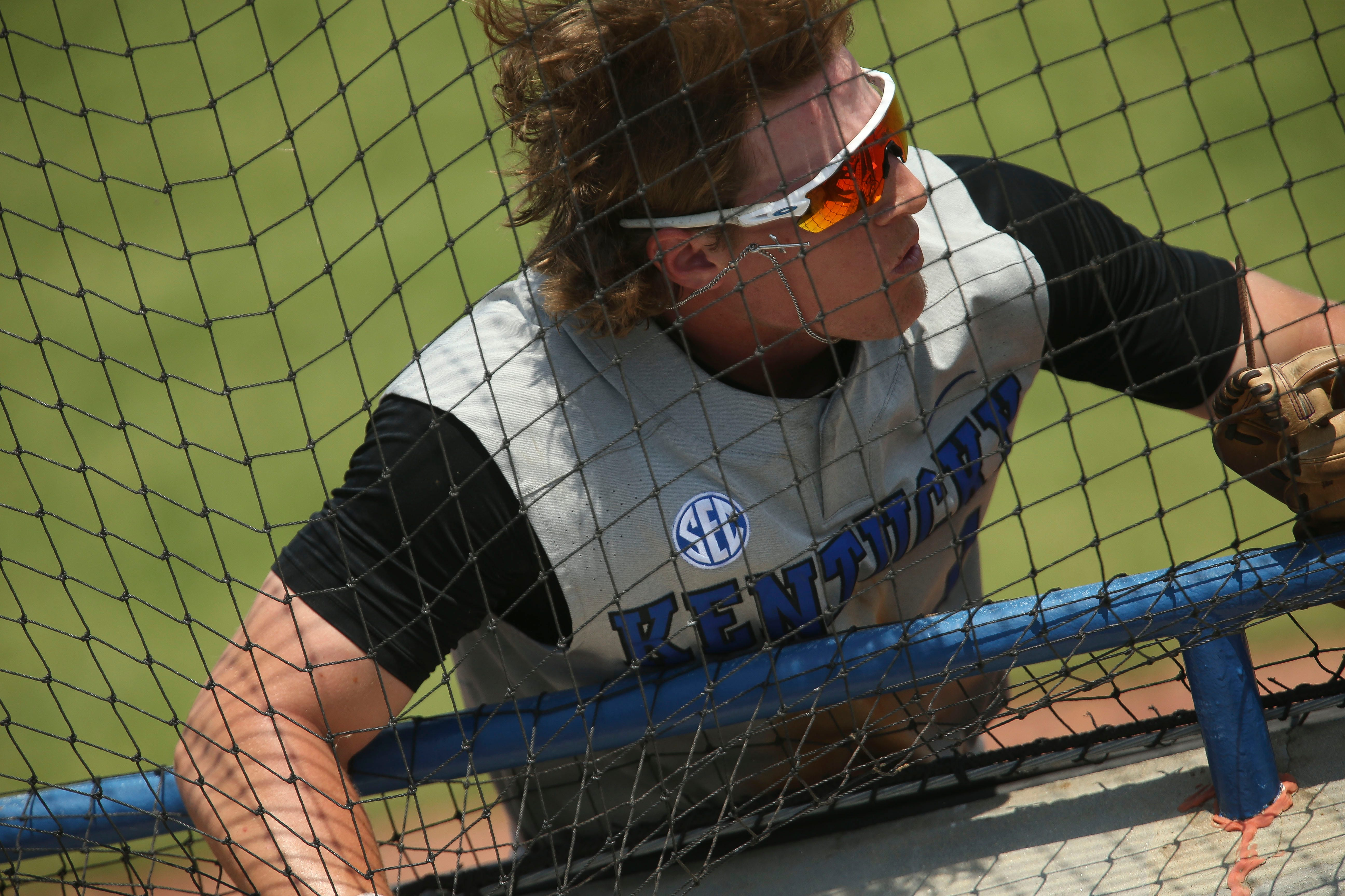 Kentucky outfielder John Rhodes (1) runs into the net along the right field line as he chases a foul fly down the line while playing against Florida during the SEC Tournament Tuesday, May 25, 2021, in the Hoover Met in Hoover, Alabama. [Staff Photo/Gary Cosby Jr.]