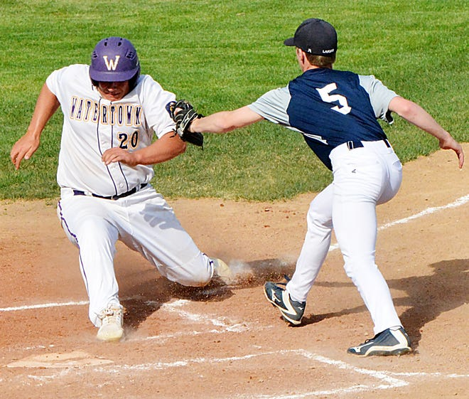 Watertown Junior Legion base runner Kolby Lacher (20) is tagged out just short of home by Lake Norden pitcher Kadyn Swenson during their baseball doubleheader Monday at Watertown Stadium.