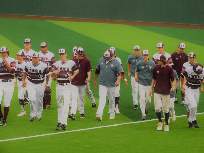 The Ennis Lions walk off the field for the final time in 2021 after a 10-0 loss to Corsicana on Saturday in their Class 5A Region II baseball quarterfinal series in Duncanville. The Lions finished the season with 20 victories.