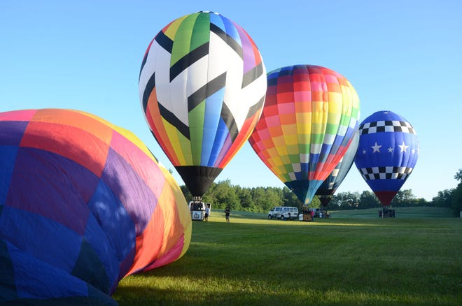 Balloons prepare to launch in 2014 and 37 pilots are scheduled to return for the 2021 Battle Creek Field of Flight.
