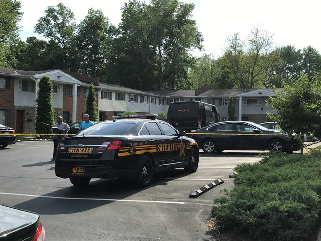 A woman was shot and killed Monday outside of the Kenwood Greene condominiums off Montgomery Road in Sycamore Township, said a Hamilton County Sheriff's Office spokeswoman.