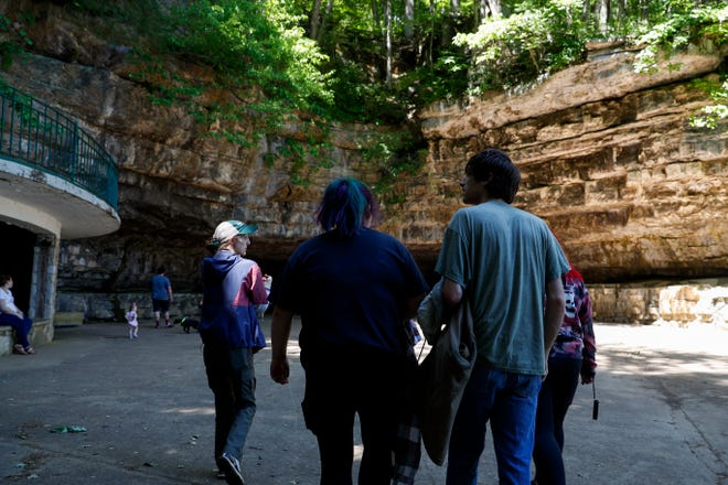 Hannah Davis, a Seasonal Interpreter Ranger, guides Alaina Wichterman, Matthew Brundage, and Azia Moore through a tour of the cave at Dunbar Cave State Park in Clarksville, Tenn., on Thursday, May 20, 2021.