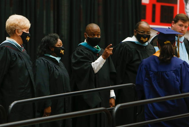 Director of Schools Millard House II points to and congratulates the class valedictorian during the 2021 graduation ceremony for Northeast High School at APSU's Dunn Center in Clarksville, Tenn., on Tuesday, May 25, 2021.
