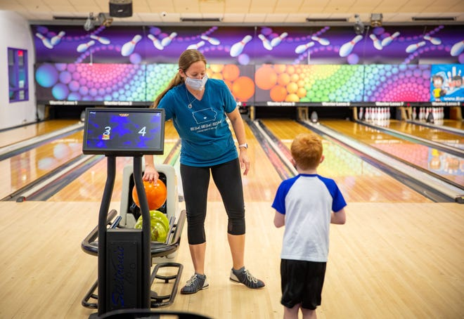 Brooke Maine and her son Luke Maine, 5, bowl at Warrior Lanes in Waukee Tuesday, May 25, 2021.