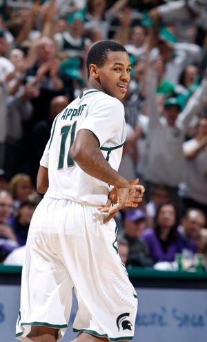 Michigan State's Keith Appling reacts after hitting a shot against Northwestern during overtime Jan. 15, 2011, in East Lansing. Appling led MSU with 19 points in a 71-67 overtime win.