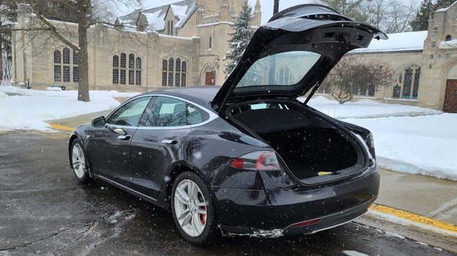 Best of both worlds. The 2015 Tesla Model S P90D features low-center-of-gravity sedan handling with the hatchback practicality of an SUV.