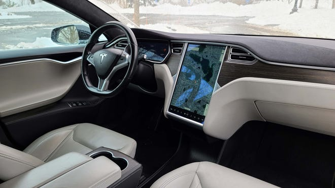 The interior of the 2015 Tesla Model S P90D. In addition to its tablet-like, 17-inch screen, the Tesla has received regular updates over the air that have made the car better on six years. Updates like Autopilot self-driving and audio features.