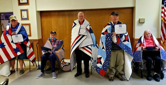 Local veterans presented with a Quilt of Valor were: (L to R) Robert Forsythe, Larry Jones, Charles Eugene Morgan, Ralph Mullins and Earnest Tinkey.
