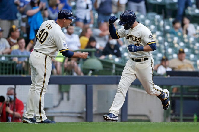 Fist bumps after Brewers home runs are the easy part of Jason Lane's job as third-base coach. Learning when to send runners home has been a trial and error process.
