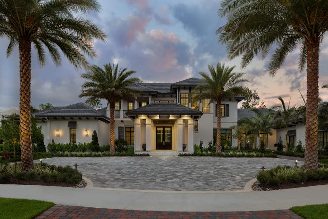 An exterior view of Diamond Custom Homes' recently-sold estate home at 6553 Highcroft Drive in Quail West Golf and Country Club.
