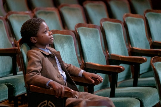 """""""Watchmen"""": Episode 1. Danny Boyd Jr. as Will Reeves, a young boy in a movie theater on May 31, 1921. He will shortly walk out into the middle of the Tulsa Race Massacre."""