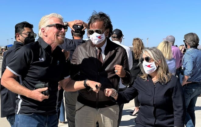 From left, Virgin Galactic founder Richard Branson, former New Mexico Gov. Bill Richardson and current Gov. Michelle Lujan Grisham at New Mexico's Spaceport America on Saturday, May 22, 2021.