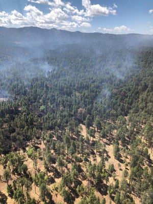 A view of the Johnson Fire, burning in the Gila National Forest, near Raw Meat Canyon May 23, 2021.