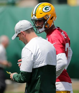 Green Bay Packers' head coach Matt LaFleur talks with Jordan Love (10) during organized team activities Tuesday, May 25, 2021, in Green Bay, Wis.