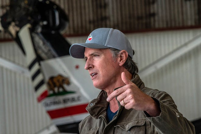 California Gov. Gavin Newsom highlights new firefighting equipment and his proposed $2 billion investment in wildfire and emergency preparedness at a press conference at Cal Fire's airbase in McClellan Park in Sacramento County on Monday, May 24, 2021. (Renee C. Byer/The Sacramento Bee via AP)