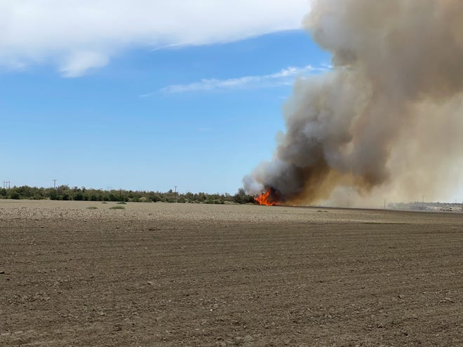 The 64 Fire in Thermal burns 20 acres, Tuesday afternoon, May 25, 2021.