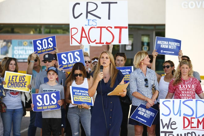 Amy Carney speaks on behalf of parents during a protest against critical race theory being taught at Scottsdale Unified School District before a digital school board meeting at Coronado High Schoo in Scottsdale on May 24, 2021.