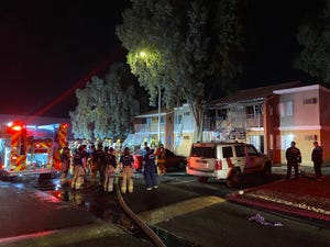 Firefighters at the scene of an apartment fire in Phoenix on May 24, 2021.