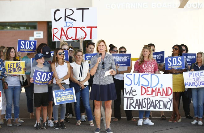 Robin Snyder speaks during a protest against the teaching critical race theory outside the Scottsdale Unified School District governing board office at Coronado High School in Scottsdale on May 24, 2021.