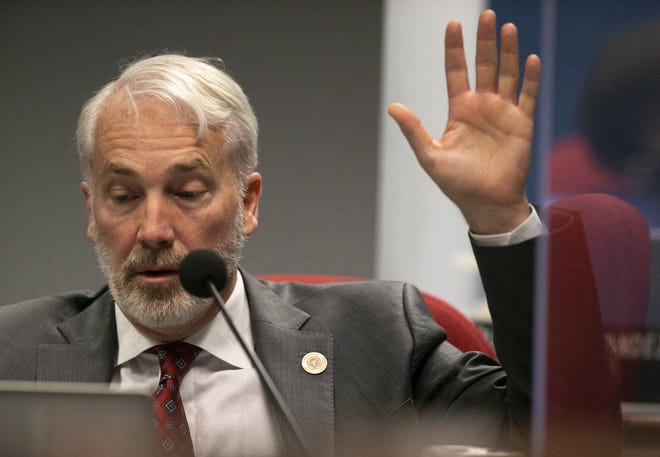 Rep. Randy Friese, D-Tucson, raises his hand to speak during debate of HB 2898, a K-12 education bill, during the House Appropriations Committee hearing  at the Arizona Capitol in Phoenix on May 25, 2021.