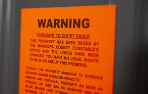 May 15, 2020; Phoenix, AZ, USA;  An eviction notice is served at an apartment in east Phoenix.