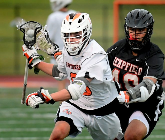 Central York's Macon Myers is chased by Hempfield's Stephen Pitts in a District 3 lacrosse semifinal at Central Monday, May 24, 2021. Bill Kalina photo