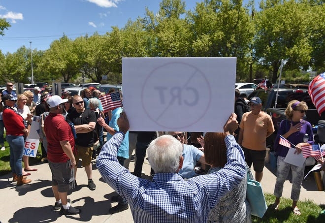 A crowd gathers outside the WCSD building to protest during the WCSD board meeting on May 25, 2021.