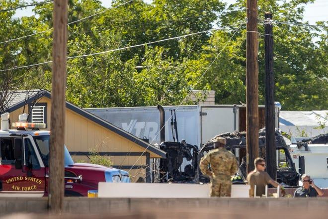 Military personnel investigate an airplane crash near Nellis Air Force Base on Monday, May 24, 2021, in Las Vegas. (L.E. Baskow/Las Vegas Review-Journal via AP)