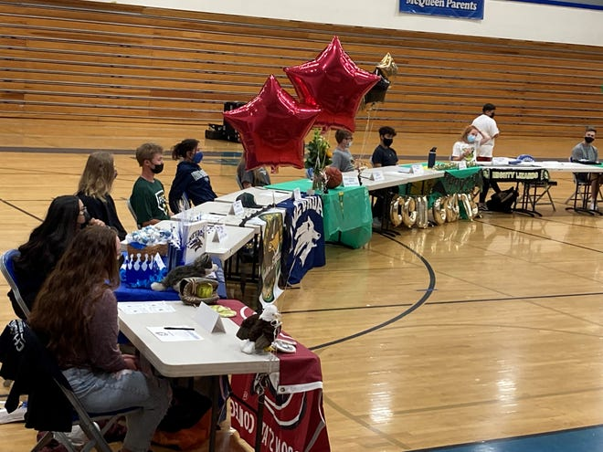 McQueen had 23 students commit to continue competing in athletics. They were honored in a ceremony at the school on Tuesday.