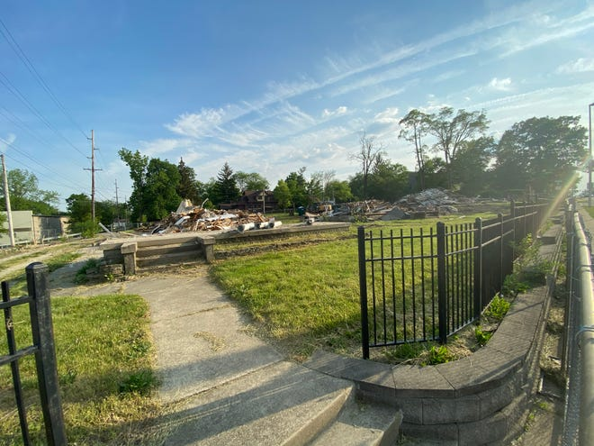 The front steps and porch remain Monday, May 24, 2021, where the house at 527 National Road W. was located before it and two other houses were razed.