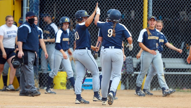 Augustana's Abby Lien (9) celebrates with teammate Mary Pardo (30) in a game earlier this year. The Vikings are the No. 1 team in Division II.