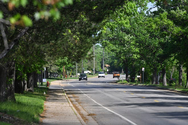 Traffic moves along Stearns County Road 1/Riverside Avenue North Tuesday, May 25, 2021, in Sartell.
