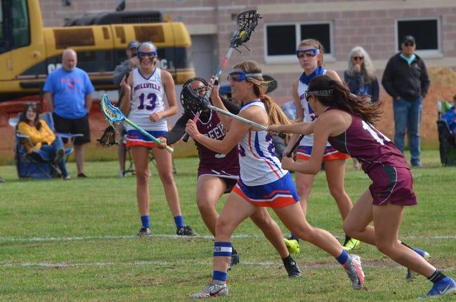 Millville senior defender Emily Thompson takes a rare 8-meter free position shot against Cedar Creek