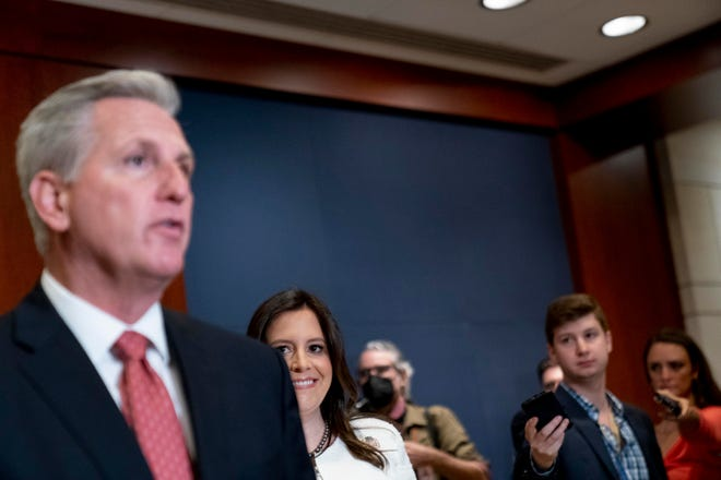 Newly-elected House Republican Conference Chair Rep. Elise Stefanik, R-N.Y., second from left, watches as House Minority Leader Kevin McCarthy of Calif., left, speaks to reporters at the Capitol in Washington, Friday, May 14, 2021.
