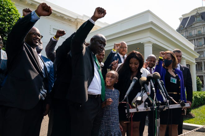 """Gianna Floyd, the daughter of George Floyd, leads the chant """"say his name"""" as members of the Floyd family talk with reporters after meeting with President Joe Biden at the White House on Tuesday."""