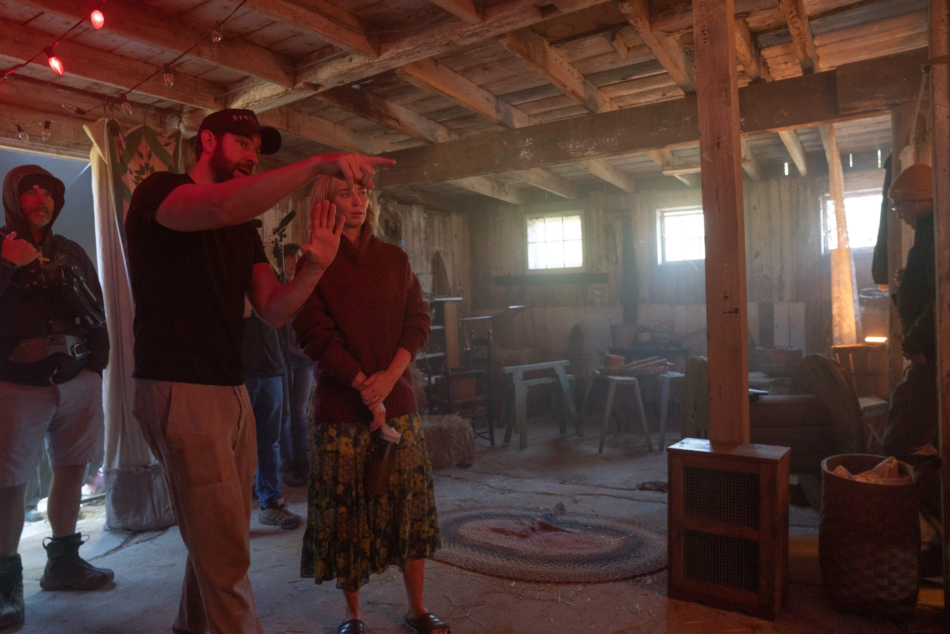 Photo of Director/writer John Krasinski, left, and star Emily Blunt on the set of