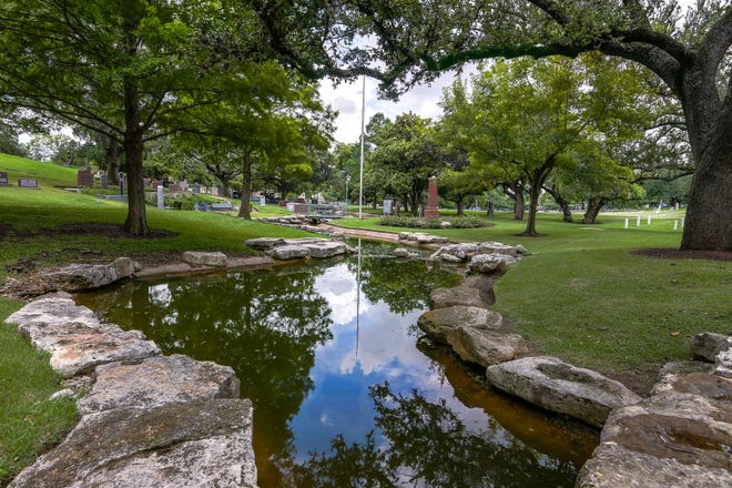 The crescent pond was added during the 1994-1997 renovation of the Texas State Cemetery.