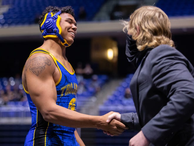 Anderson's Kelby Hickerson shakes hands with Carrollton Creekview coach Sean Kitchen at the Class 5A state meet last month in Cypress. Hickerson reached the final of the 220-pound division before suffering his first loss of the season.