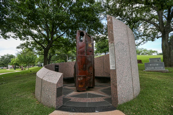 Metal beams salvaged from the World Trade Center after the Sept. 11, 2001, terrorist attacks sit in a monument at the Texas State Cemetery